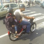 Family travelling on a moped in Rabat, Morocco