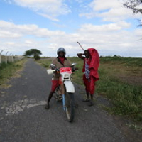 "I came across the guy on the right trying to inflate the front tyre of the motorcycle, while it still had a punctured inner tube. Near Arusha, Tanzania. • <a style=""font-size:0.8em;"" href=""http://www.flickr.com/photos/50948792@N02/14402047762/"" target=""_blank"">View on Flickr</a>"