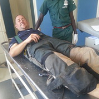 "Steve on the bare metal gurney in triage at Mazabuka District Hospital, Zambia • <a style=""font-size:0.8em;"" href=""http://www.flickr.com/photos/50948792@N02/14660371473/"" target=""_blank"">View on Flickr</a>"