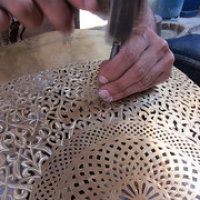 "Morocco: A craftsman adding the leaf effect to a copper template in the kazbah, Marrakesh, Morocco • <a style=""font-size:0.8em;"" href=""http://www.flickr.com/photos/50948792@N02/10113231493/"" target=""_blank"">View on Flickr</a>"