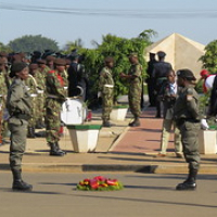 "Female military police officers flank a wreath in the middle of a roundabout in Chimoio, Mozambique • <a style=""font-size:0.8em;"" href=""http://www.flickr.com/photos/50948792@N02/14417193303/"" target=""_blank"">View on Flickr</a>"
